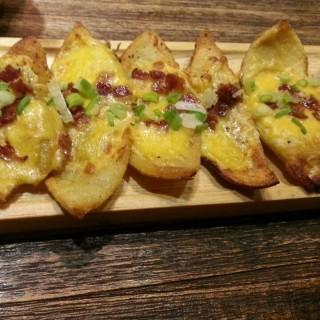 Potato Skin with Cheese and Bacon -  dari Carnivor Barbeque Specialist (Pantai Indah Kapuk) di Pantai Indah Kapuk |Jakarta